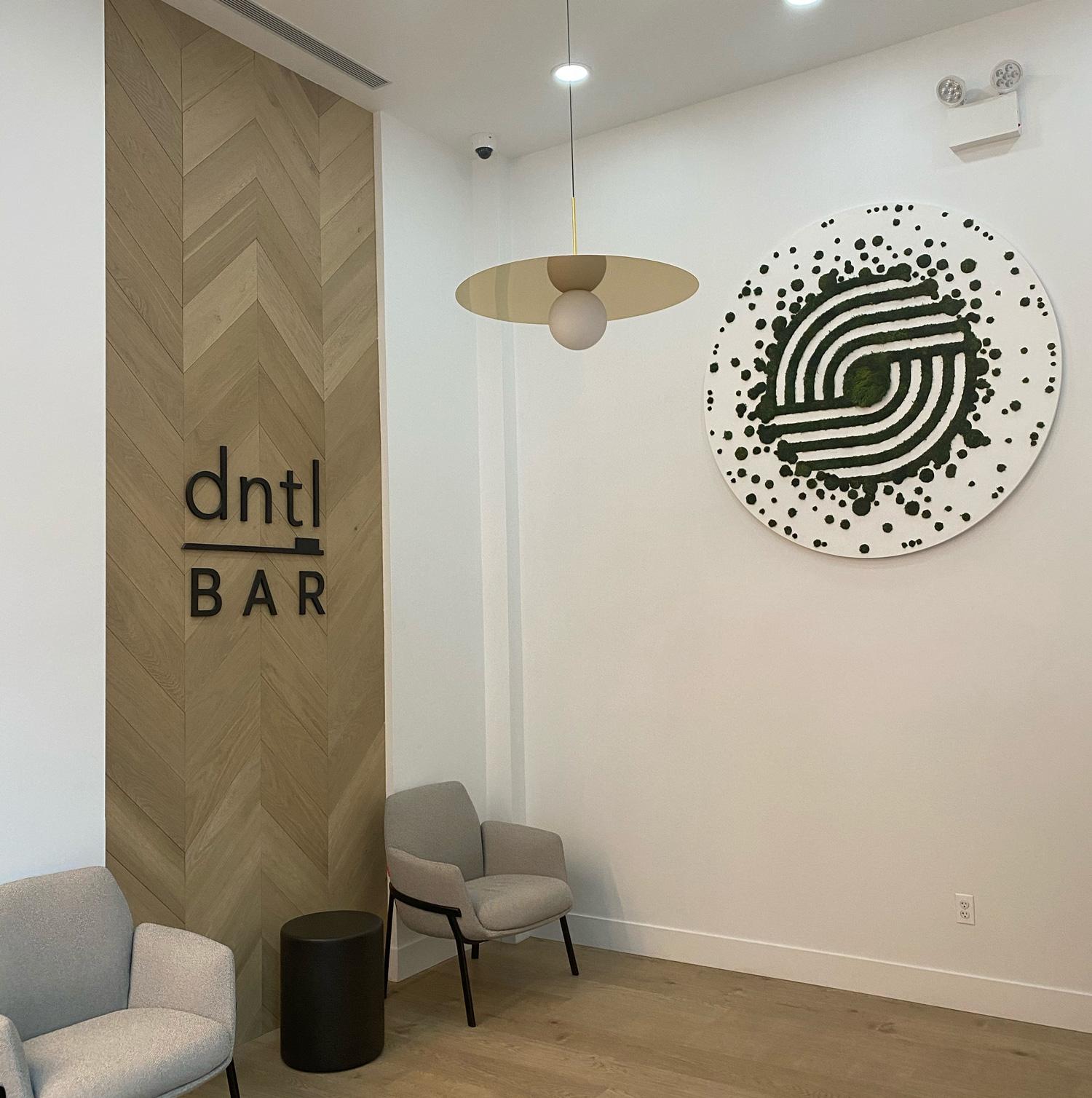 dntl bar Union Square location lobby with dntl bar logo sign and artwork on walls